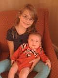 Meredith got to hold cousin Travor for the first time...