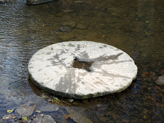 Millstone in the river