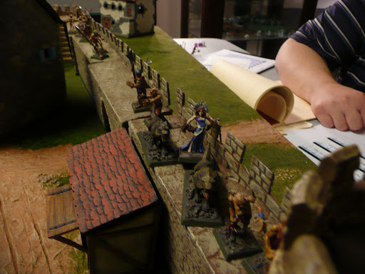 Mircalla and her wolves along with some zombies and skeletons gain the eastern span of the north wall unopposed.