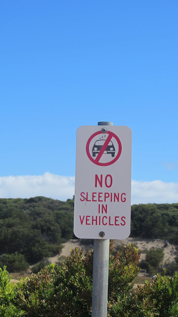 Local officials enforce policies prohibiting free camping on the Great Ocean Road.