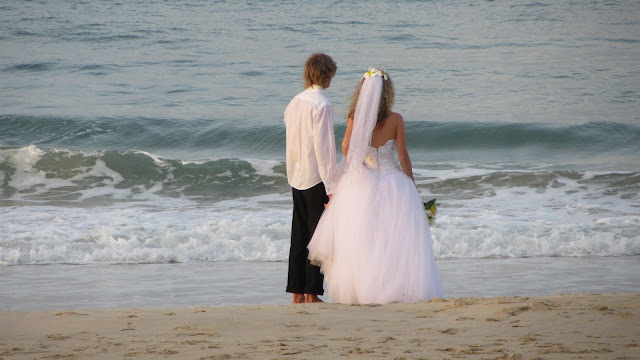 Wedding photos on Noosa's beach. The couple appeared to be about 16 years old.