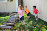 """Our preschoolers love running around and being active in the natural play area. Logs, leaves, grass all engage them and ensure they will not suffer from """"nature deficit disorder."""""""
