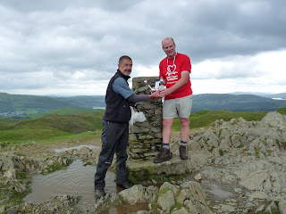 Dave Dimmock presents Richard with his bottle of Thwaites Wainwright