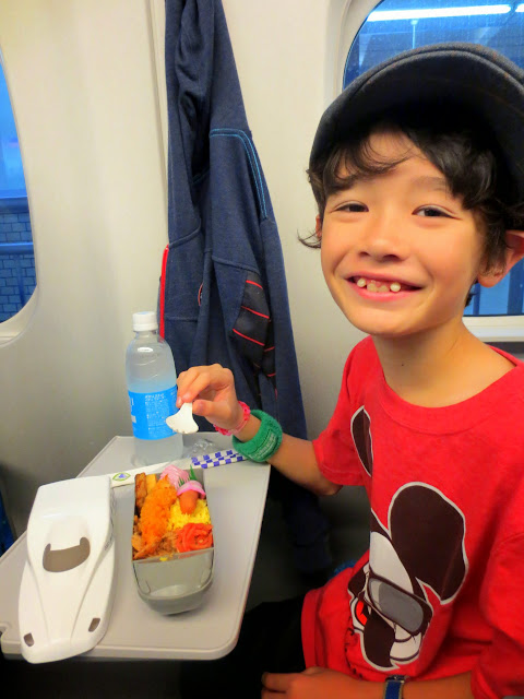 Eidan enjoying his kids' eki bento on the shinkansen to Osaka