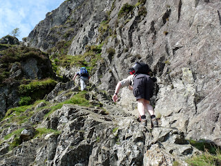 Two walkers start the scramble up Jacks Rake
