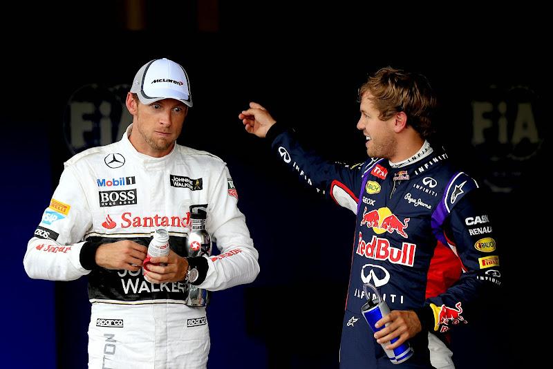 надувшийся Дженсон Баттон и Себастьян Феттель после квалификации на Гран-при Великобритании 2014