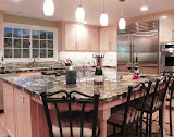 Bushman Kitchen 1 of 5 - This beautiful, large kitchen got a complete facelift with natural maple cabinets, stainless steel appliances, granite countertops, stone backsplash, and updated lighting.