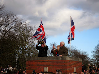 Mick Pepper holds the ball up high for the Shrovetide crowds to see