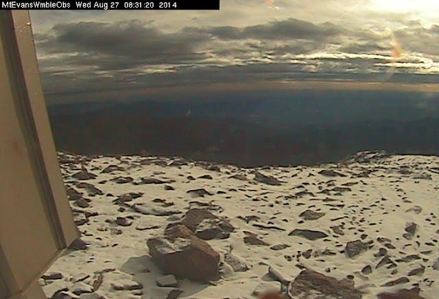 August 27, 2014 - Dawn reveals fresh snow on top of Mount Evans. (DU)