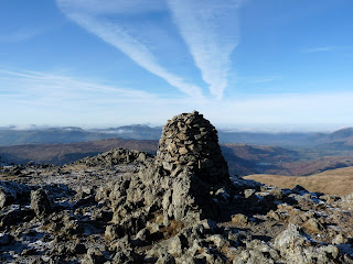 Raise summit with what looks like a chimney of smoke!