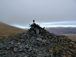 Skiddaw Lesser Man summit. A tangled mess of ironwork adorns the cairn.