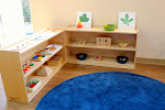 In the Montessori toddler rooms, we display many enticing activities on low, accessible shelfs. Each activity has its own place. This supports the toddlers' natural sense of order, and enables them to be independent in their classroom.