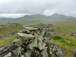 Great Crag Summit in the pouring rain.
