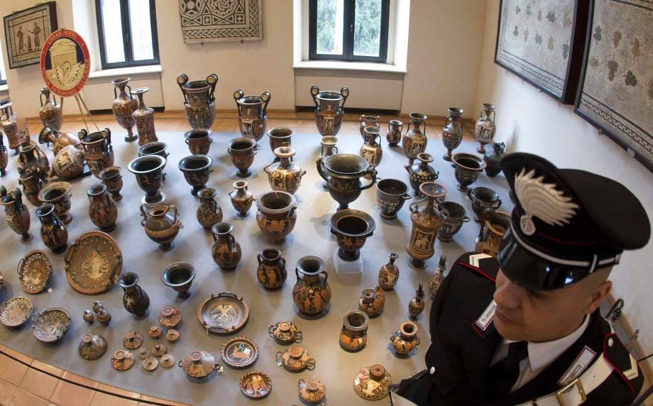 Italy unveils record haul of looted antiquities