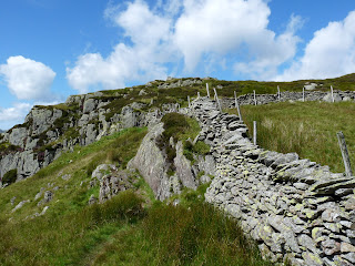 Nearing the end of the wall to cross another stile to Eagle Crag.