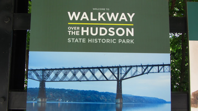 Signs welcoming visitors to the Walkway Over the Hudson.