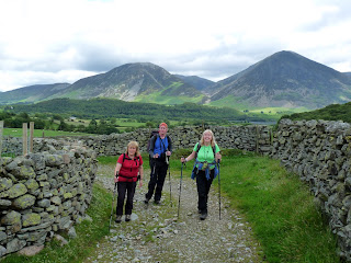 Ann, Chris and Lin on path towards Hen Comb. Whiteside and Grasmoor are in the background.