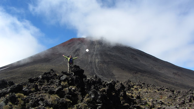 """Heather and a slightly cloud-obscured """"Mt. Doom""""."""