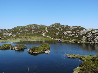 Innominate Tarn - The path on the far side continues to the summit of Haystacks.