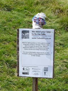 "A sign from ""Fix the Fells"" as we ascended up the Stake Pass."