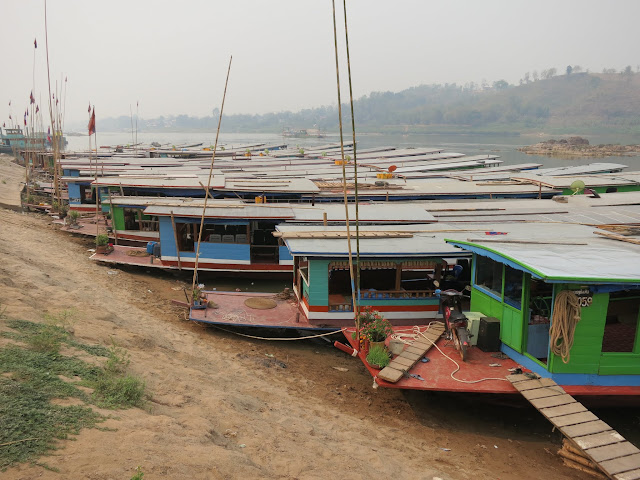 Which boat!? Slow boats lining the banks of the Mekong.
