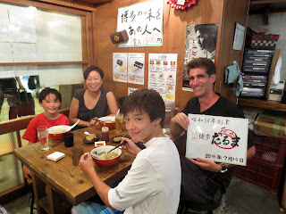 "Dinner at Daruma ramen. I agreed to hold this sign after Maria assured me it didn't say ""another gaijin sucker"""