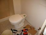 The toilet tank taken off...