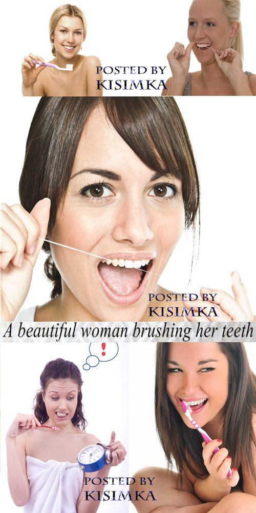 Stock Photo: A beautiful woman brushing her teeth
