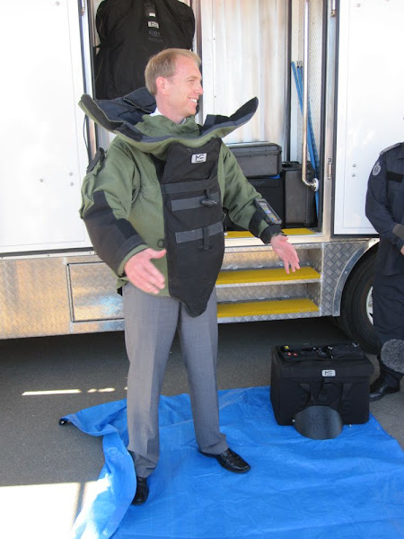 Simon Corbell in a bomb suit