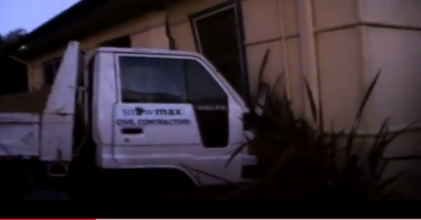 truck runs into house