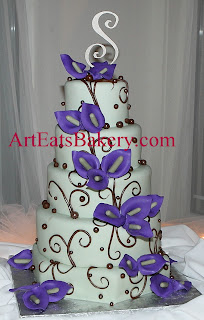 Five tier green fondant, bronze swirls, pearls, and purple sugar calla lillies custom unique wedding cake