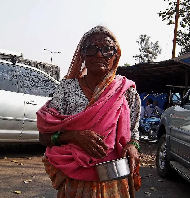 closeup of old woman beggar