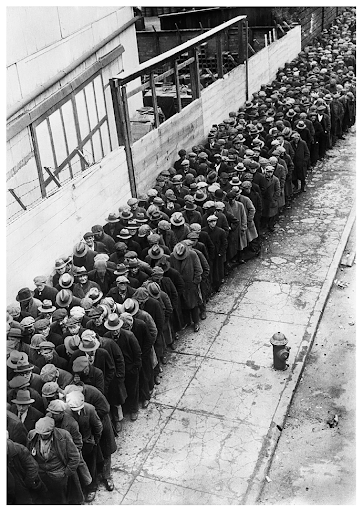 The homeless and unemployed of the Great Depression wait in line seeking shelter in New York