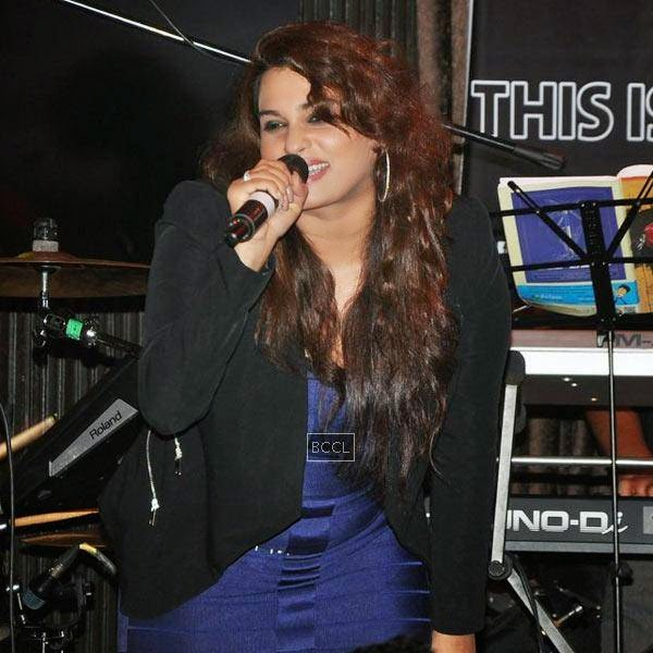 A singer performs during Ankit Tiwari's live concert, held at Hard Rock Cafe, on July 11, 2014.(Pic: Viral Bhayani)
