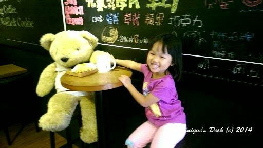 Tiger girl posing with the huge teddy