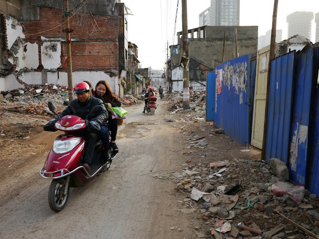 man and two women riding on a motorbike at Beizheng Street in Changsha