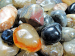 A great example of the many colors of agate:  white to dark grey, pale to mid blue, pale orange to vivid red, black. Minerals that influence stone color include iron oxides (red, brown, black, green) and manganese (pink, violet, black).