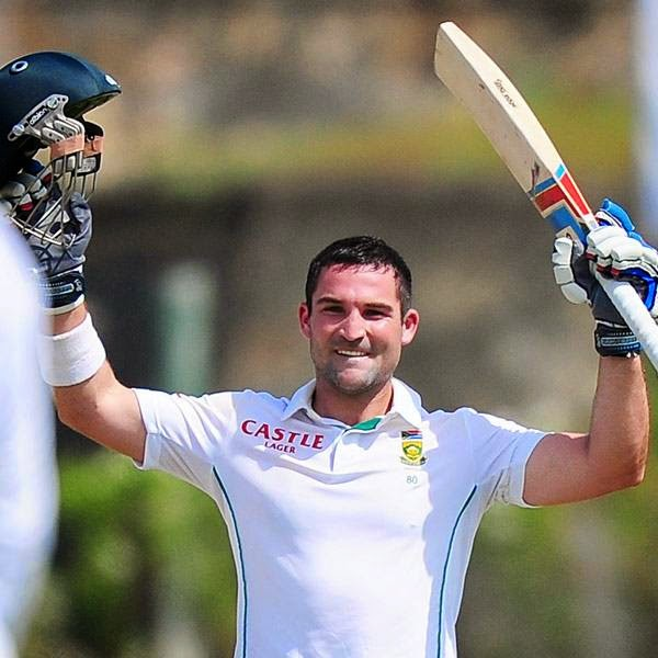 South Africa cricketer Dean Elgar raises his bat and helmet in celebration after scoring a century (100 runs) during the first day of the opening Test match between Sri Lanka and South Africa at the Galle International Cricket Stadium in Galle on July 16, 2014.