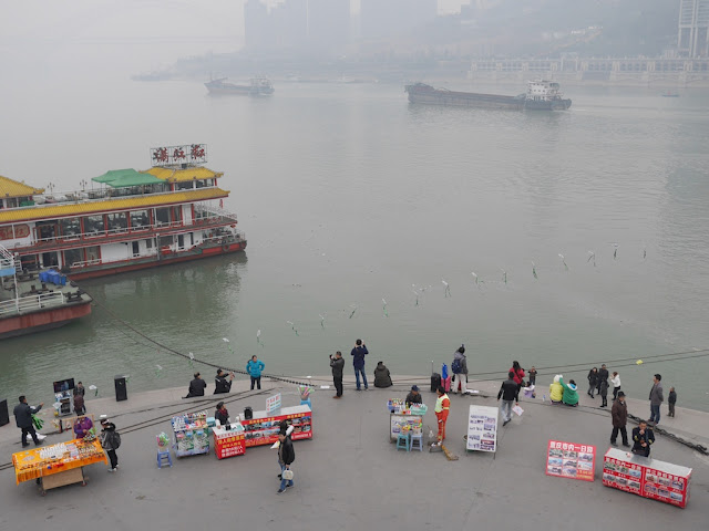 visitors and vendors at the tip of Chaotianmen