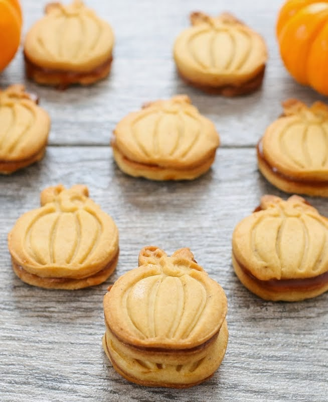 photo of Pumpkin Spice Shortbread Cookies lined up on a board