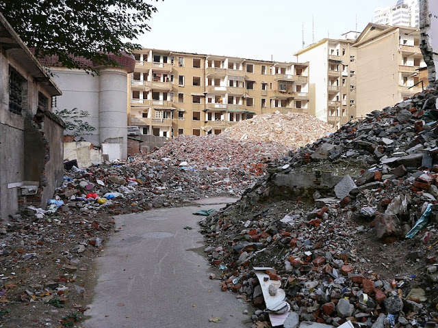 a narrow alley through the remaining rubble of demolished buildings near Beizheng Street in Changsha
