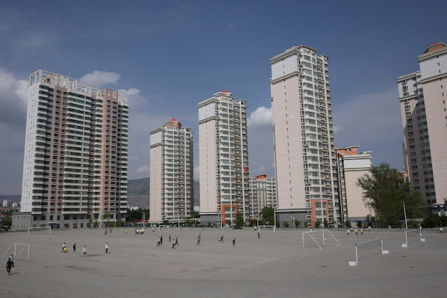 concrete sports field and apartment buildings in Xining, Qinghai