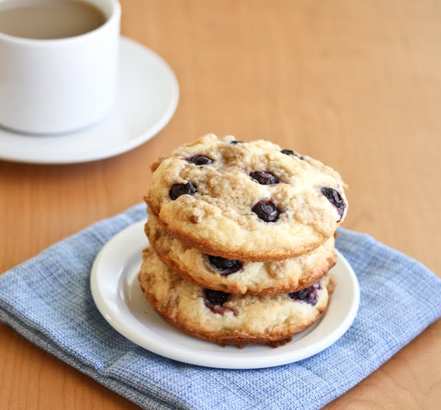 Blueberry Coffee Cake Cookies on a plate with coffee in the background