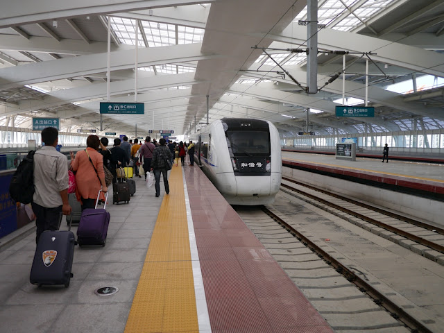 passengers boarding a train at the Zhuhai Railway Station