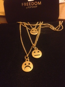 Gold Necklace with Mixed Emotions
