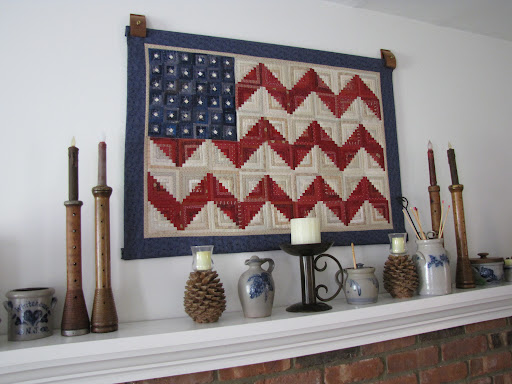 Paper-pieced american flag above the mantle. Glorious!