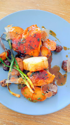 Chicken leg confit with cracked rye porridge, sunchokes, potatoes, green garlic, and chicken jus at Glyph Café & Art Space