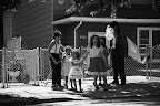 Neighborhood kids getting scared by Woo Woo - Photography by Lisa Weatherbee