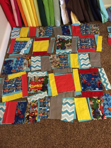 rag quilt laid out before being sewn by avisiontoremember