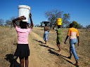 Girls always carry pretty much everything on their head... the buckets are FULL of water... that's about 25L, VERY HEAVY!